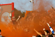Blackpool fans let a flare off to celebrate their teams goal during the EFL Sky Bet League 1 match between Accrington Stanley and Blackpool at the Fraser Eagle Stadium, Accrington, England on 21 September 2019.