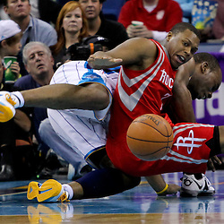 April 19, 2012; New Orleans, LA, USA; New Orleans Hornets power forward Carl Landry (24) and Houston Rockets point guard Kyle Lowry (7) get tied up on a loose ball during the second half at the New Orleans Arena. The Hornets defeated the Rockets 105-99.   Mandatory Credit: Derick E. Hingle-US PRESSWIRE