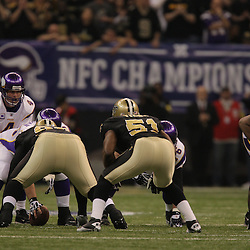 Jan 24, 2010; New Orleans, LA, USA; Minnesota Vikings quarterback Brett Favre (4) lines up under center during a 31-28 overtime victory by the New Orleans Saints over the Minnesota Vikings in the 2010 NFC Championship game at the Louisiana Superdome. Mandatory Credit: Derick E. Hingle-US PRESSWIRE.