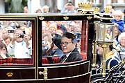 Prinsjesdag 2013 Prins Constantijn groet het publiek vanuit de Gouden Koets op weg naar Paleis Nooreinde<br /> <br /> Budget Day 2013 Prince Constantijn greeting the public from the Golden Carriage