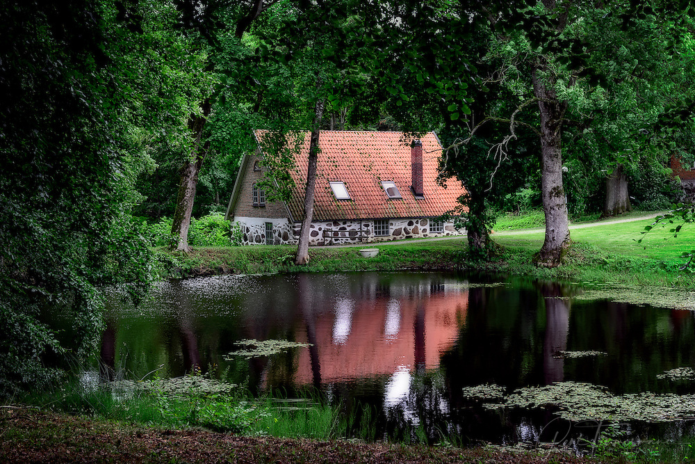 An old house near a lake in a forest in the south-east of Sweden.