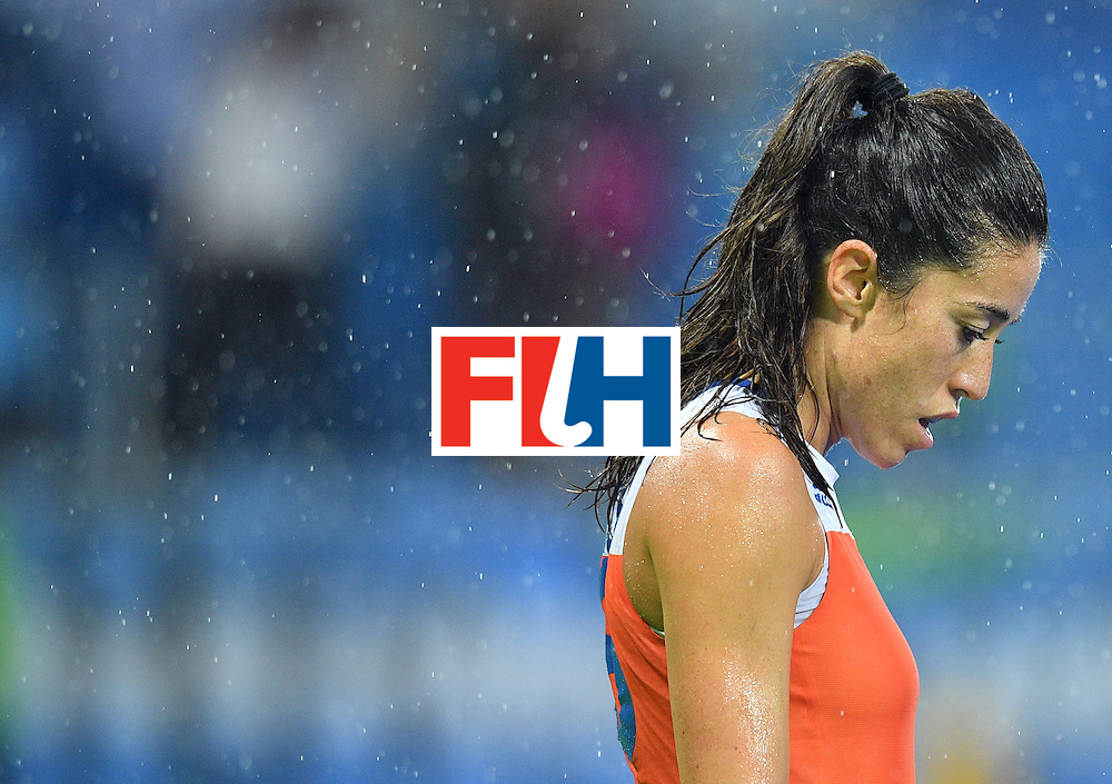 Netherland's Naomi van As stands in the rain during the women's quarterfinal field hockey Netherlands vs Argentina match of the Rio 2016 Olympics Games at the Olympic Hockey Centre in Rio de Janeiro on August 15, 2016. / AFP / Carl DE SOUZA        (Photo credit should read CARL DE SOUZA/AFP/Getty Images)