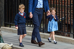 The Duke of Cambridge with Prince George and Princess Charlotte arriving at the Lindo Wing at St Mary's Hospital in Paddington, London. Photo credit should read: Matt Crossick/EMPICS Entertainment