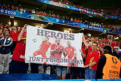 "LILLE, FRANCE - Friday, July 1, 2016: Wales supporters with a banner ""Heroes just for one day"" celebrate the 3-1 victory against Belgium at full time after the UEFA Euro 2016 Championship Quarter-Final match at the Stade Pierre Mauroy. Aaron Ramsey, Gareth Bale, captain Ashley Williams. (Pic by Paul Greenwood/Propaganda)"