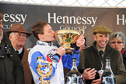 Jockey of Diamond Harry winner of the 2010 Hennessy Gold Cup DARYL JACOB and right trainer NICK WILLIAMS at the Hennessy Gold Cup 2010 at Newbury Racecourse, Berkshire on 27th November 2010.