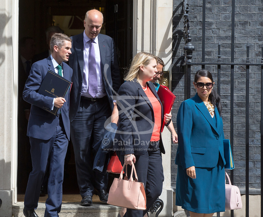 London, July 18th 2017. In a clear demonstration of unity with a cabinet that has seemed to be split over Brexit and other issues,  Government ministers, L-R Chief Whip (Parliamentary Secretary to the Treasury) Gavin Williamson, Transport Secretary Chris Grayling, Secretary of State for Culture, Media and Sport Karen Bradley, Lord Privy Seal and Leader of the House of Lords Baroness Natalie Evans and International Development Secretary Priti Patel leave the last cabinet meeting together before the Parliamentary summer recess at Downing Street in London.