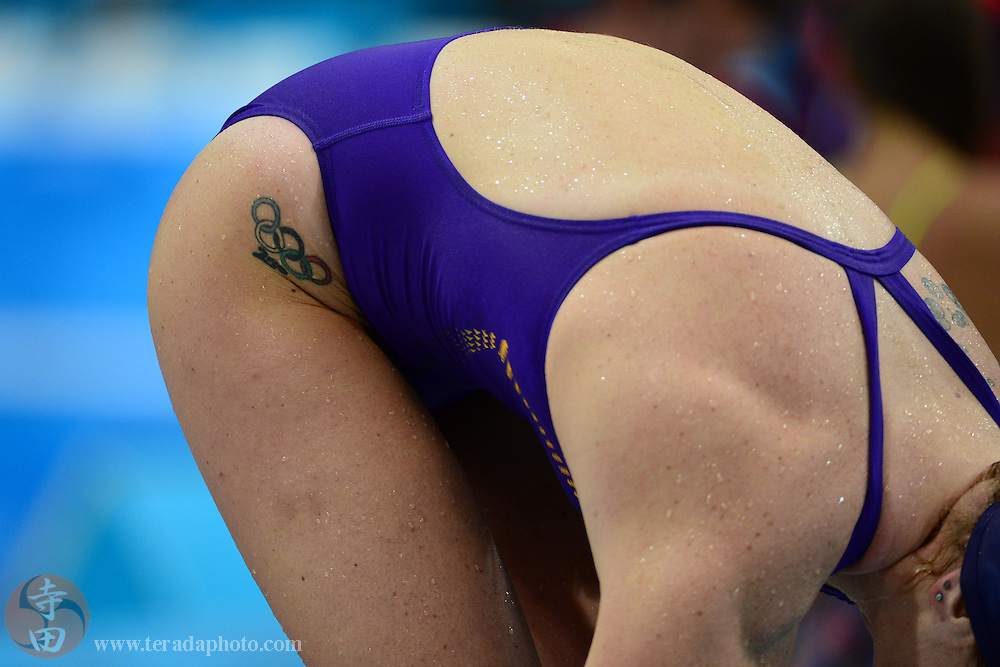 Jul 29, 2012; London, United Kingdom; Detail view of an Olympic rings tattoo on a female swimmer before day two of the London 2012 Olympic Games at Aquatics Centre.