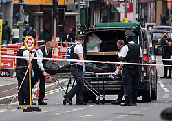 © Licensed to London News Pictures. 07/07/2019. London, UK. A body being removed from the scene where a man in his 20s has been shot dead in Leyton, East London in the early hours of this morning. Photo credit: Ben Cawthra/LNP