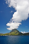Clouds are generated as wind passes over Bora Bora's double peaks of Mount Pahia and Mount Otemanu. Bora Bora is one of the Leeward Islands in the Society Islands archipelago of French Polynesia.
