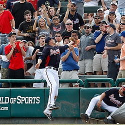March 5, 2011; Lake Buena Vista, FL, USA; A fan catches a foul ball over Atlanta Braves outfielder Joe Mather (4) during a spring training exhibition game against the New York Mets at Disney Wide World of Sports complex.  Mandatory Credit: Derick E. Hingle