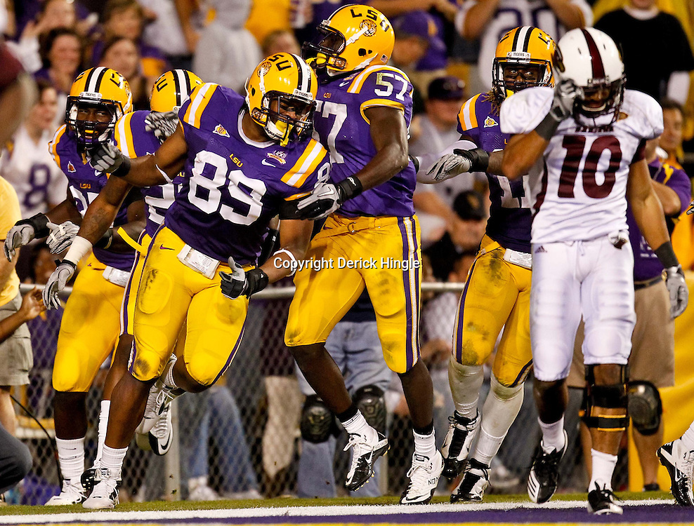 November 13, 2010; Baton Rouge, LA, USA; LSU Tigers defensive end Lavar Edwards (89) celebrates with teammates after returning a Louisiana Monroe Warhawks fumble for a touchdown during the second half at Tiger Stadium. LSU defeated Louisiana-Monroe 51-0.  Mandatory Credit: Derick E. Hingle