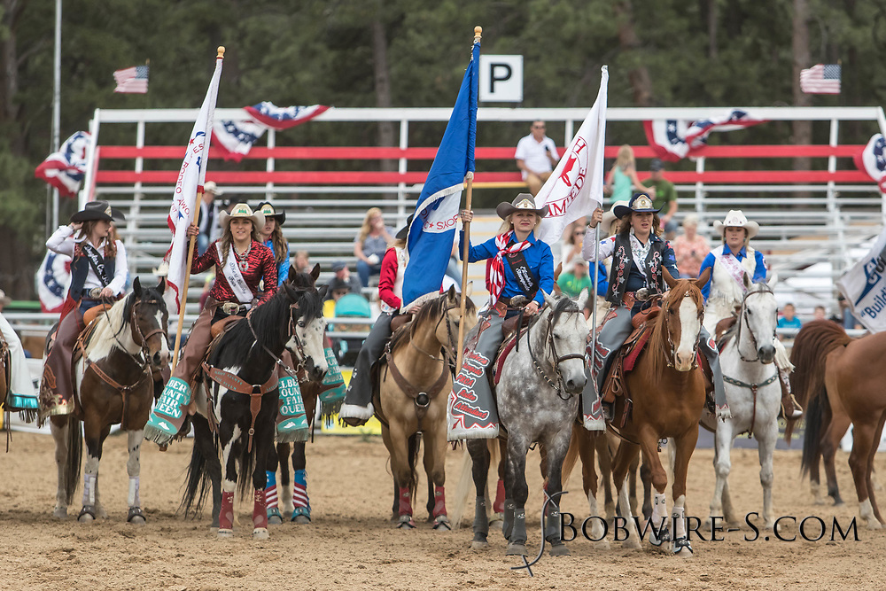 Queen Cassidy Esposito, center right, and attendant Brittany Vogl during the grand entry of the third performance of the Elizabeth Stampede on Sunday, June 3, 2018.