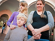 tucsonshooting - 09 JANUARY 2011 - TUCSON, AZ: Michael Hill, 5, (CQ) his sister, Marilyn Hill, 12, (CQ) and mother, Emmaline Hill (CQ) gathered in downtown Tucson Sunday to pray for Congresswoman Gabrielle Giffords and other victims of the mass shooting that took place Saturday.   ARIZONA REPUBLIC PHOTO BY JACK KURTZ