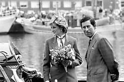 The Prince and Princess of Wales on a boat in Livorno (Leghorn) harbour. The boat is being sailed out to meet the Royal Yacht Britannia.