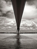 the Pont de Normandie near to Honfleur in Normandy, France. The Pont de Normandie (or Bridge of Normandy) is a cable-stayed road bridge that spans the river Seine linking Le Havre to Honfleur in Normandy, northern France.