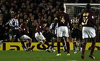 Photo: Chris Ratcliffe.<br /> Arsenal v Juventus. UEFA Champions League. Quarter-Finals. 28/03/2006.<br /> Cesc Fabregas scoring the opening goal for Arsenal