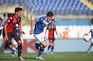 Genoa's Italian midfielder Paolo Ghiglione and Brescia Calcio's Italian midfielder Andrea Ghezzi races after the ball during the Serie A match at Stadio Mario Rigamonti, Brecsia. Picture date: 27th June 2020. Picture credit should read: Jonathan Moscrop/Sportimage