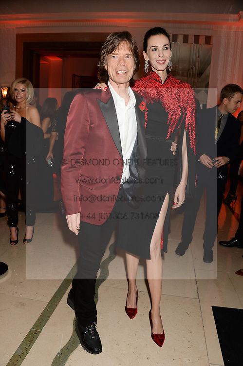 SIR MICK JAGGER and L'WREN SCOTT at the Harper???s Bazaar Women of the Year 2013 in association with Estée Lauder, Audemars Piguet and Selfridges & Co. held at Claridge's, Brook Street, London on 5th November 2013.