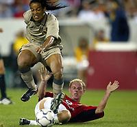 Photo Aidan Ellis.<br />Manchester United v Barcelona (at the Lincoln Financial Field Philadelphia) 03/08/03.<br />United's Nicky Butt challenges Barcelona's Ronaldinho