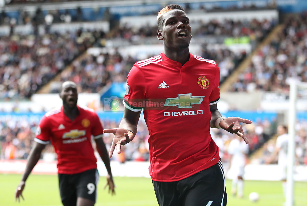 Manchester United's Paul Pogba celebrates scoring his side's third goal during the Premier League match at the Liberty Stadium, Swansea.