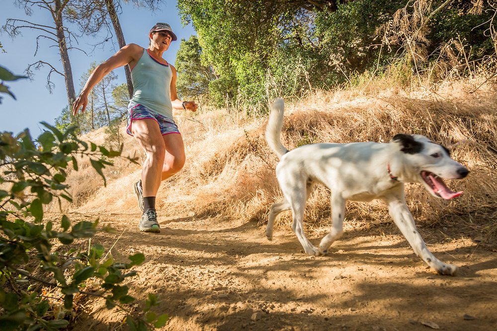 Rachel Melick runs with her dog, Zeke, on Oak Hill Mine Trail in Calistoga.