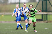 Brighton's Kate Natkiel and Forest Green's Sophie Okey challenge for the ball during the FA Women's Premier League match between Forest Green Rovers Ladies and Brighton Ladies at the Hartpury College, United Kingdom on 24 January 2016. Photo by Shane Healey.