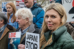 © Licensed to London News Pictures. 26/01/2019. London, UK. Former Conservative Party Director of Communications Carrie Symonds (R) stands alongside Stanley Johnson (2-R) at a demonstration in London against Japanese whaling. Photo credit: Rob Pinney/LNP