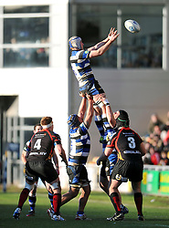 Mat Gilbert (Bath) rises high to win lineout ball - Photo mandatory by-line: Patrick Khachfe/JMP - Tel: Mobile: 07966 386802 11/01/2014 - SPORT - RUGBY UNION -  Rodney Parade, Newport - Newport Gwent Dragons v Bath - Amlin Challenge Cup.