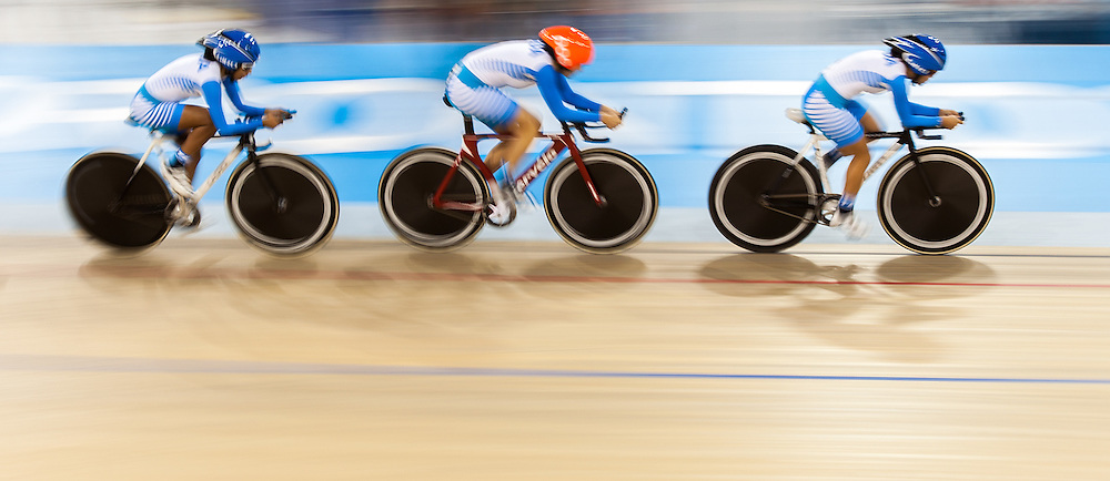 The Guatemalan team competes in the women's team pursuit qualification on the fist day of track cycling at the 2015 Pan American Games in Toronto, Canada, July 16,  2015.  AFP PHOTO/GEOFF ROBINS