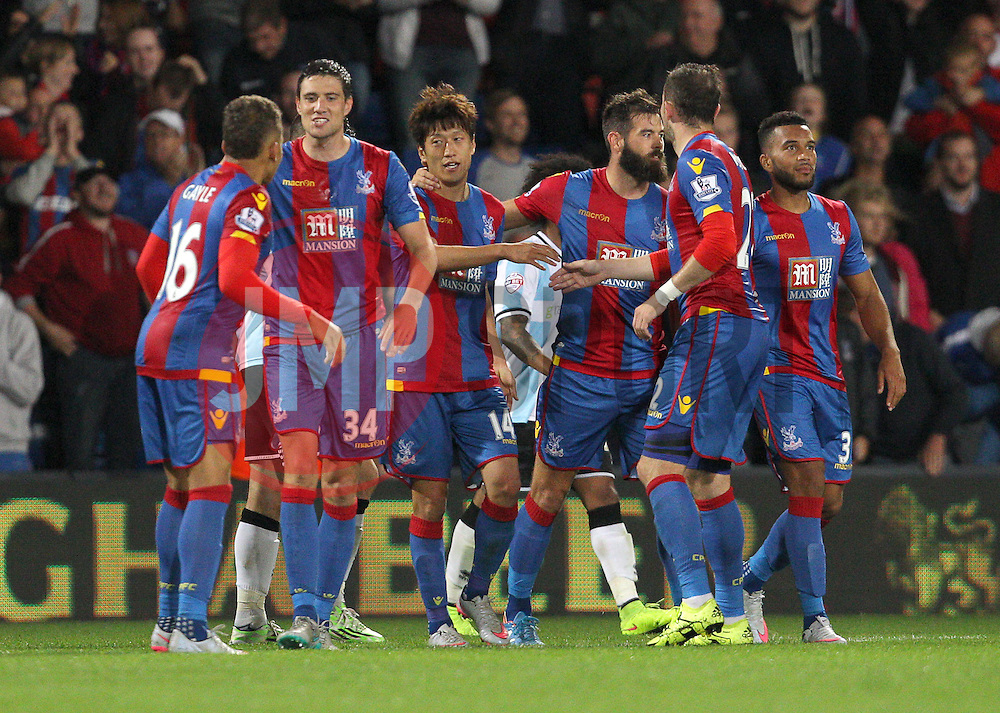 Lee Chung-Yong ( 3rd L ) of Crystal Palace celebrates with team mates after scoring to make it 3-1 - Mandatory byline: Paul Terry/JMP - 07966386802 - 25/08/2015 - FOOTBALL - Selhurst Park -London,England - Crystal Palace v Shrewsbury town - Capital One Cup - Second Round