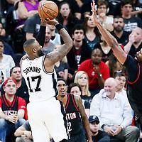 03 May 2017: San Antonio Spurs guard Jonathon Simmons (17) takes a jump shot over Houston Rockets center Nene Hilario (42) during the San Antonio Spurs 121-96 victory over the Houston Rockets, in game 2 of the Western Conference Semi Finals, at the AT&T Center, San Antonio, Texas, USA.