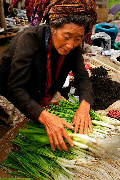 Minority women selling goods at market at Inle region