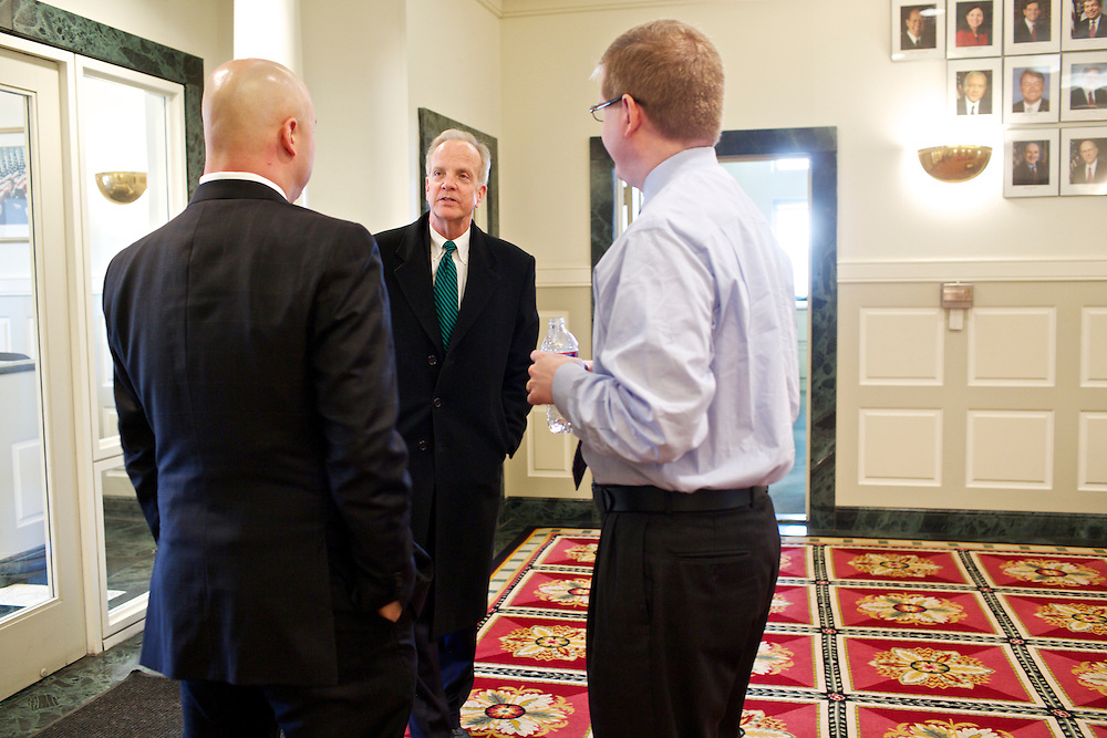 U.S. Sen. Jerry Moran (R-KS) was elected Chairman of the National Republican Senatorial Committee. Moran, left, talks to National Republican Senatorial Committee Executive Director Rob Collins, right, and  Political Director Ward Baker at the Ronald Reagan Republican Center on Thursday, March 7, 2013.