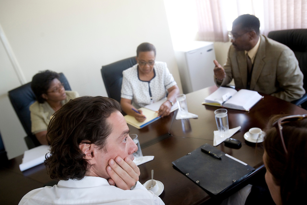 Left to right, Anita Dolmas, Judicial Advisor; David Koubbi; Marie Antoinette Cayemette, Judicial Advisor; Jude Hervey Day, Chief of Cabinet; and Emmanuelle Guerry, adopting mother and president of SOS Haiti Enfants Adoptes, meet at the Prime Minister's office. Koubbi, a French lawyer, visits Haiti to advocate to the Haitian government for passports for 56 children. The children were in the adoption process before the earthquake and though the adoptions have all been finalized, the children need passports before they can join their adopted families in France.
