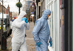 © Licensed to London News Pictures. 16/11/2015. London, UK. Police officers and forensics at a property on Harrow Road, north west London where a man in his 30's was found dead at the scene by paramedics. A 24-year-old woman was arrested at the scene on suspicion of murder . Photo credit: Ben Cawthra/LNP