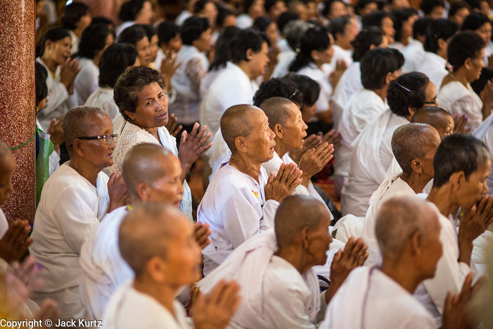 "04 FEBRUARY 2013 - PHNOM PENH, CAMBODIA:  Cambodians pray during a cremation chanting service for King-Father Norodom Sihanouk at Wat Ounalom (also spelled Wat Onalaom) in Phnom Penh. Norodom Sihanouk (31 October 1922 - 15 October 2012) was the King of Cambodia from 1941 to 1955 and again from 1993 to 2004. He was the effective ruler of Cambodia from 1953 to 1970. After his second abdication in 2004, he was given the honorific of ""The King-Father of Cambodia."" Sihanouk died in Beijing, China, where he was receiving medical care, on Oct. 15, 2012.   PHOTO BY JACK KURTZ"