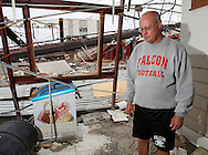 Ed Thomas, of Parkersburg, a teacher and football coach, stands in the entryway to the former gym of Aplington-Parkersburg High School in Parkersburg, Iowa on Wednesday June 4, 2008. (Stephen Mally for the New York Times)