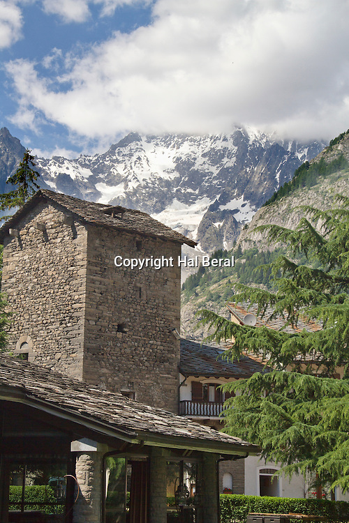 Mount Blanc looms over the Italian village of Courmayeur<br /> Courmayeur,Italy