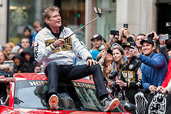 © Licensed to London News Pictures. 02/05/2016. London, UK. Actor, David Hasselhoff, arrives riding on the top of a surpercar. Large crowds come to Regent Street to see the arrivals of supercars in the Gumball 3000 race.  Supercars race from Dublin to Bucharest, stopping at major cities en route including London. Photo credit : Stephen Chung/LNP