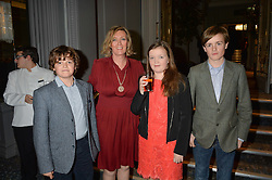 ANNABEL BUTLER and her children, left to right, RAFFERTY BUTLER, ISABELLA BUTLER and MONGO BUTLER at a party to celebrate the publication of Thenford: The Creation of an English Garden by Michael & Anne Heseltine held at The Grosvenor House Hotel, Park Lane, London on 24th October 2016.