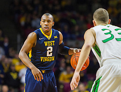 Dec 17, 2015; Charleston, WV, USA; West Virginia Mountaineers guard Jevon Carter (2) dribbles at the top of the key during the first half against the Marshall Thundering Herd at the Charleston Civic Center . Mandatory Credit: Ben Queen-USA TODAY Sports
