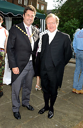 Left toright, the Lord Mayor of Westminster COUNCILLOR TIM JOINER and Black Rod SIR MICHAEL WILLCOCKS at the annual House of Lords v House of Commons tug of war match in aid of  of  Macmillan Cancer Relief on 21st June 2005.  A drinks reception was held in College Gardens followd by the tug of war on Victoria Tower Gardens, London.                                 <br /><br />NON EXCLUSIVE - WORLD RIGHTS