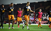 Michael Dawson leads the warm up ahead of the Sky Bet Championship match between Brentford and Hull City at Griffin Park, London, England on 3 November 2015. Photo by Michael Hulf.