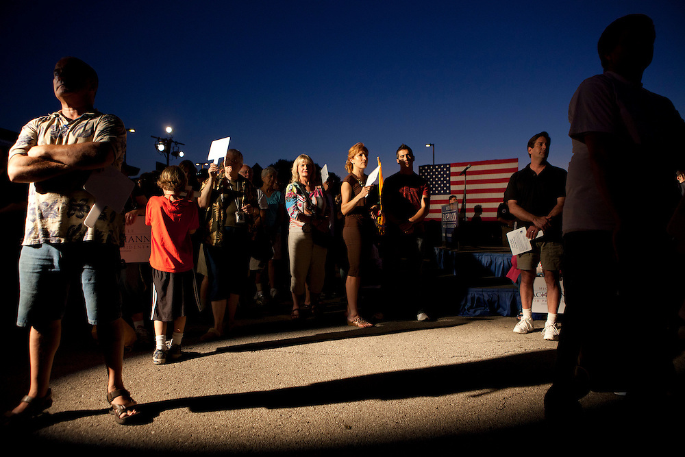 People await the start of a rally for Republican presidential hopeful Michele Bachmann on Friday, August 12, 2011 in Ames, IA.