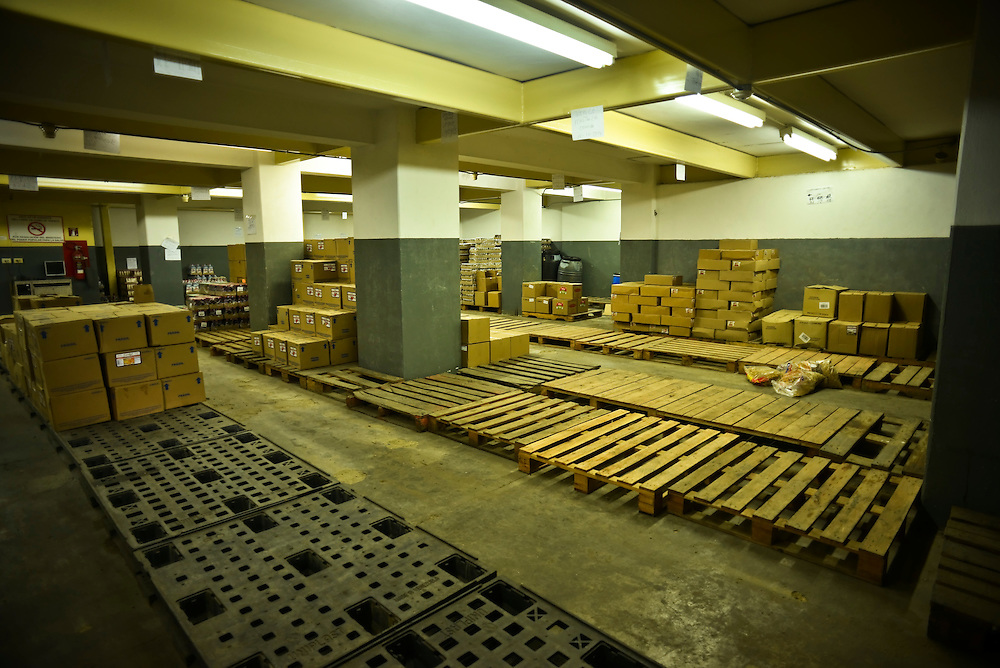 "Empty pallets abound at a private sector food distributor's warehouse in central Caracas. According to the manager, he has not been able to stock basic food items like sugar, coffee, meat or milk for weeks because of nationwide food shortages.  The Chavez government has launched a nationwide campaign to crack down on over-pricing and hording the government blames for shortages of basic goods. The National Guard regularly inspects grocery stores and distributors' storage facilities, often televising raids.  According to the manager, this warehouse as raided last week, however he didn't receive any fines or sanctions, he recalled, throwing up his hands as he said frustrated,""we have nothing, because I can't buy anything!"""