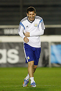 Lionel Messi (captain) of Argentina laughs during the Argentina training session at the Est&aacute;dio S&atilde;o Janu&aacute;rio, Rio de Janeiro, ahead of tomorrow's World Cup Final.<br /> Picture by Andrew Tobin/Focus Images Ltd +44 7710 761829<br /> 12/07/2014