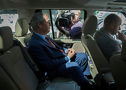 © Licensed to London News Pictures. 04/07/2016. London, UK. Nigel Farage is driven away from the Emanuel Centre after announcing his intention to stand down as UKIP party leader. Photo credit: Peter Macdiarmid/LNP
