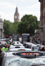 Image ©Licensed to i-Images Picture Agency. 11/06/2014. London, United Kingdom. Drivers of London black cabs \'gridlock\' the area around Whitehall. Drivers of black cabs \'gridlock\' the area around Trafalgar Square and government buildings on Whitehall in a protest against the Uber app-based service. Trafalgar Square. Picture by Daniel Leal-Olivas / i-Images