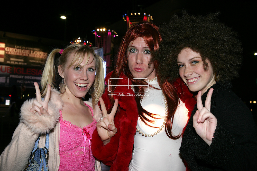 5th December 2007, Los Angeles, California. The Spice Girls preform at the Staples Center in Downtown Los Angeles, which is part of 'The Return Of The Spice Girls' world tour. Pictured is L-R Marina Lovelady, 17; Charles Coulter, 22 and Alex Hannant, 19, outside the venue before the show..PHOTO © JOHN CHAPPLE / REBEL IMAGES.john@chapple.biz   www.chapple.biz