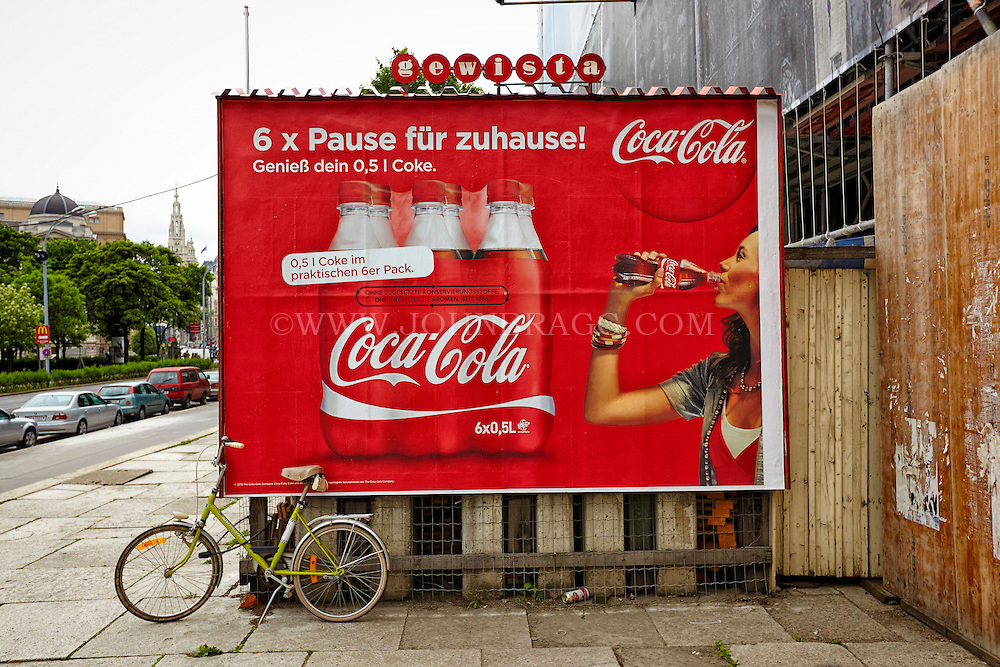 View of a German Coca-Cola billboard, Vienna, Austria.